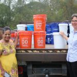 Yolanda Adams and The Rev. Brenda Lewis with a truckload of Clean-Up Buckets